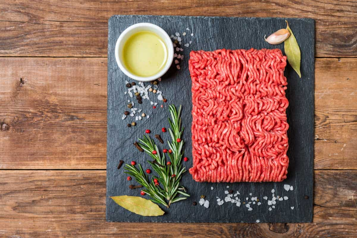 Ground meat on slate with spices