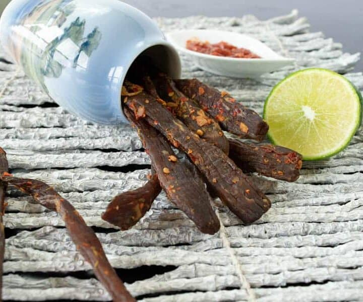 Chili Lime jerky with lime and chili garlic sauce in jar