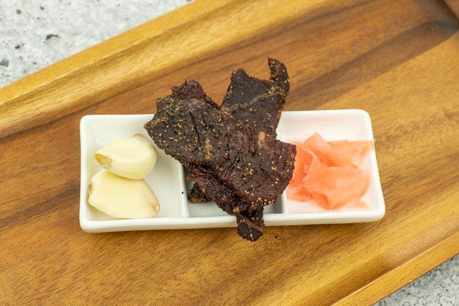 Teriyaki jerky on tray with garlic