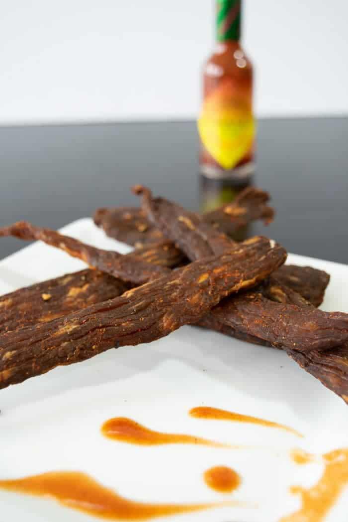 Habanero Tabasco beef jerky on white plate