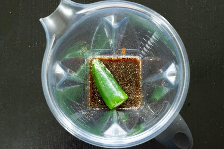 Jerky ingredients in blender with jalapeno on top