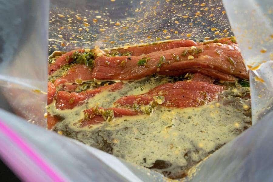 Jalapeno jerky marinating in ziplock bag