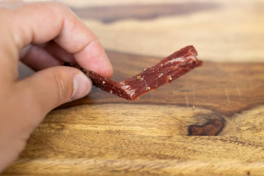 Testing jerky by bending it to see if its finished