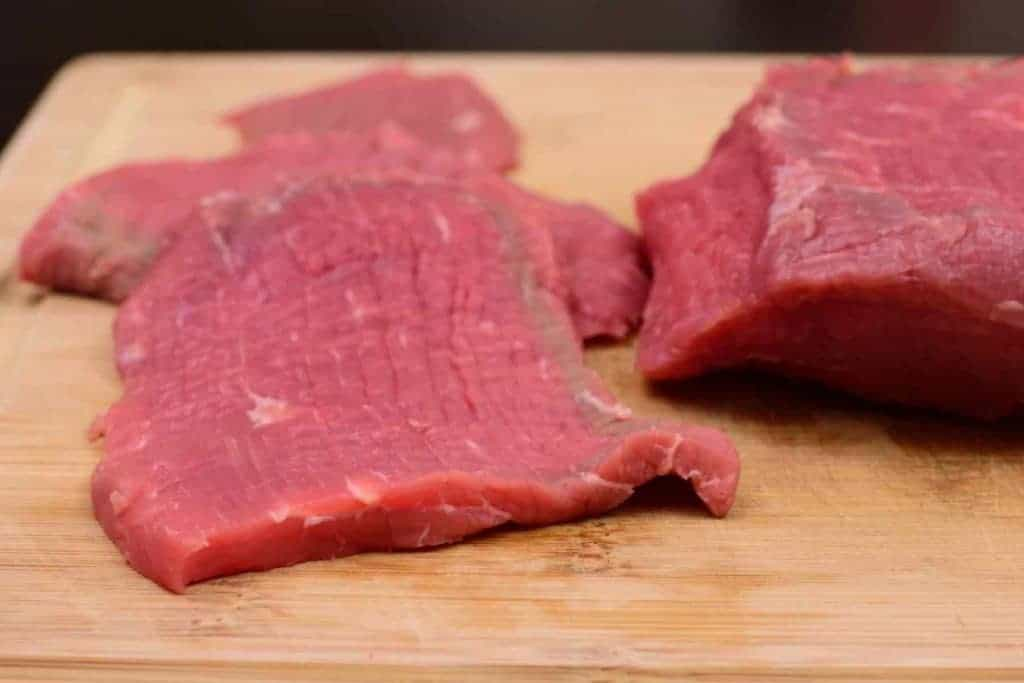 Lean Eye of Round Roast Sliced Thin and Ready to Marinate