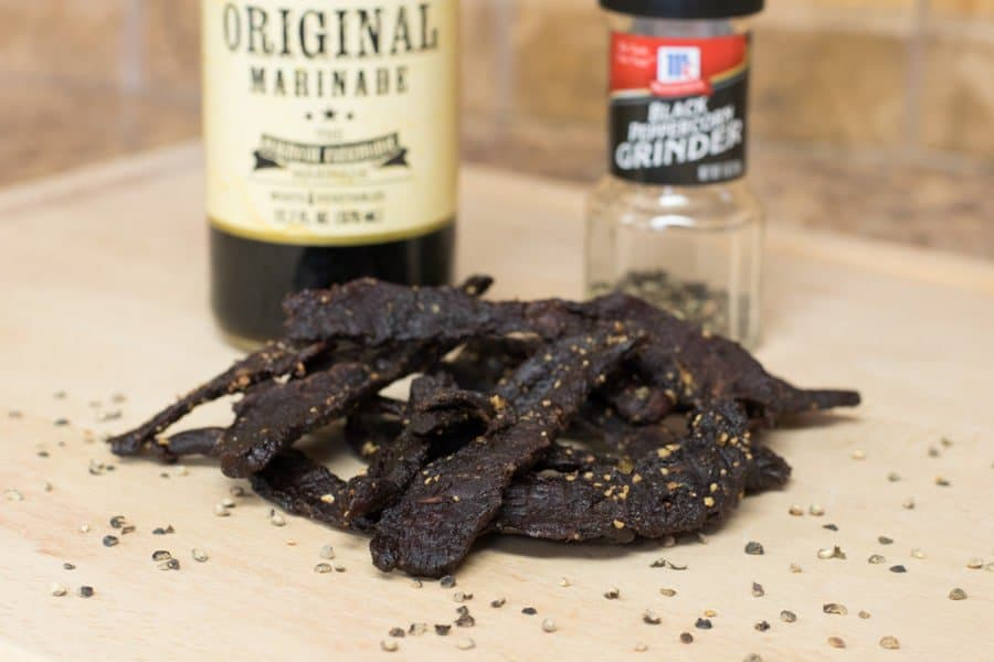 Elk jerky with marinade and ground black pepper