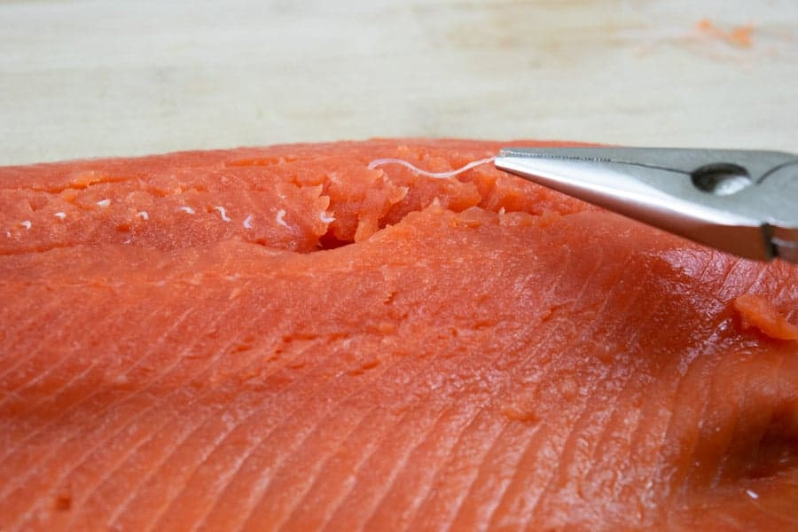 Removing pin bones from salmon filet