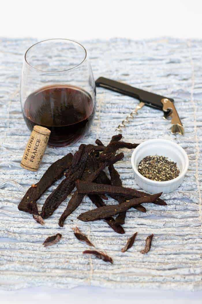 Corkscrew deer jerky finished with wine, corkscrew, salt, and pepper