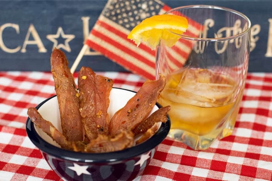 Citrus Bourbon Jerky with american flag with glass of bourbon