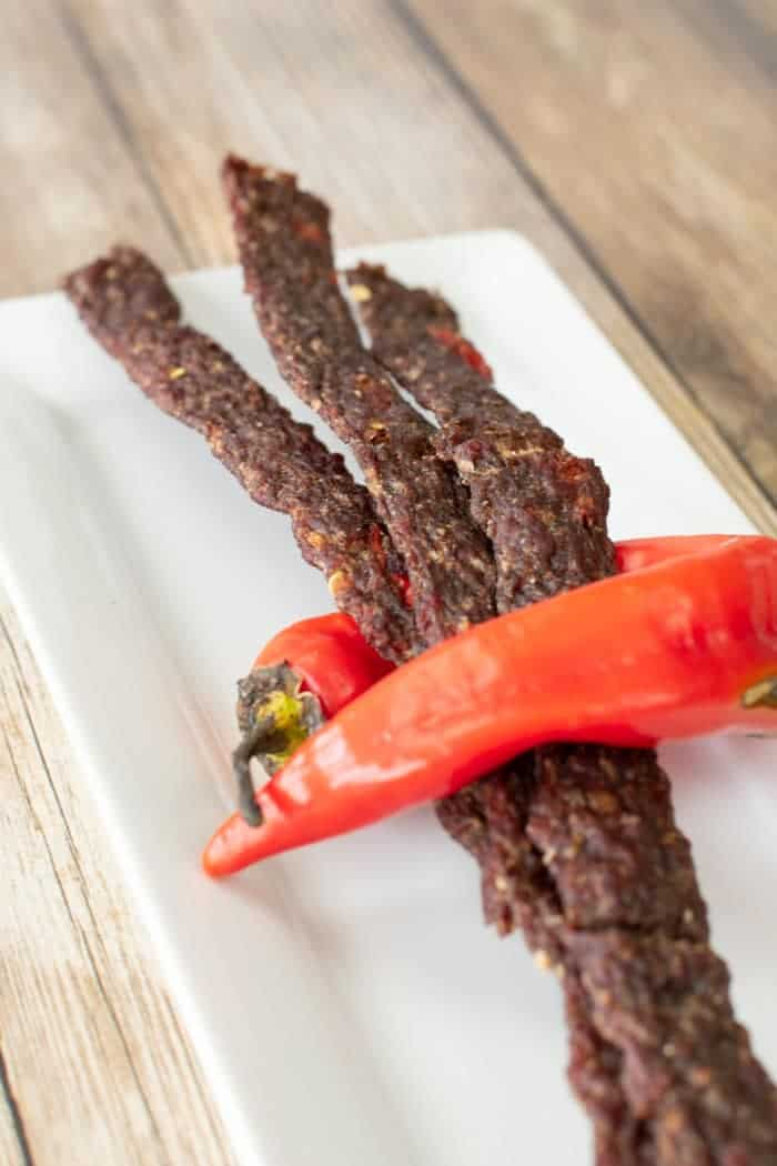 Spicy ground beef jerky wrapped by a hot banana pepper