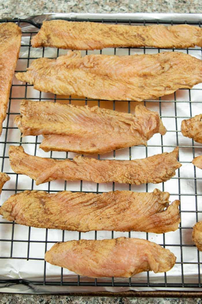 Mole turkey jerky on oven rack for preheat