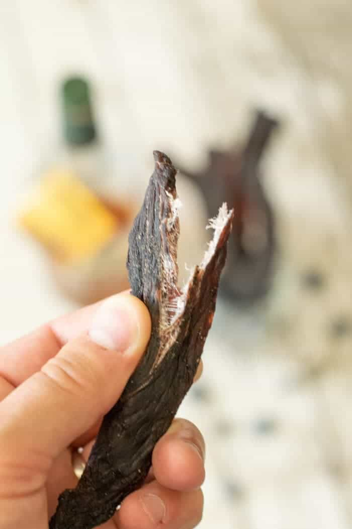 Deer jerky strip finished and showing white fibers