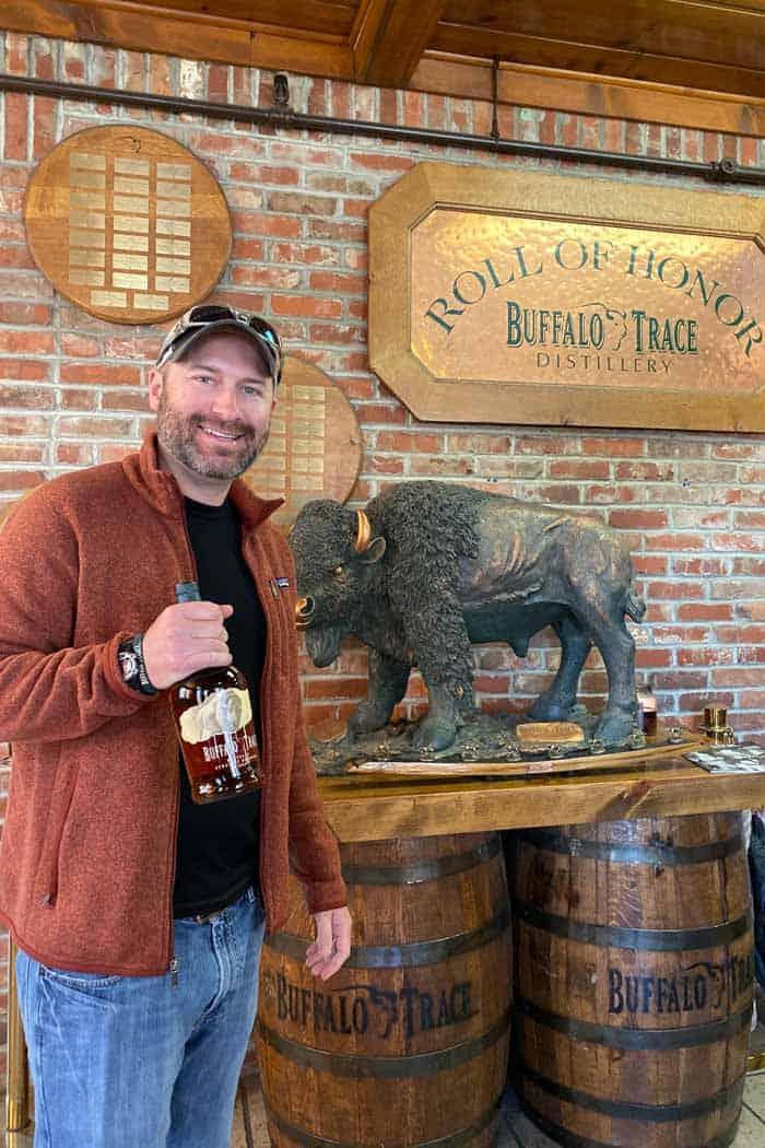 Buffalo trace brewery holding bottle of bourbon