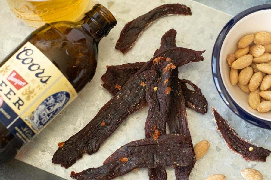 Deer jerky finished with beer in background