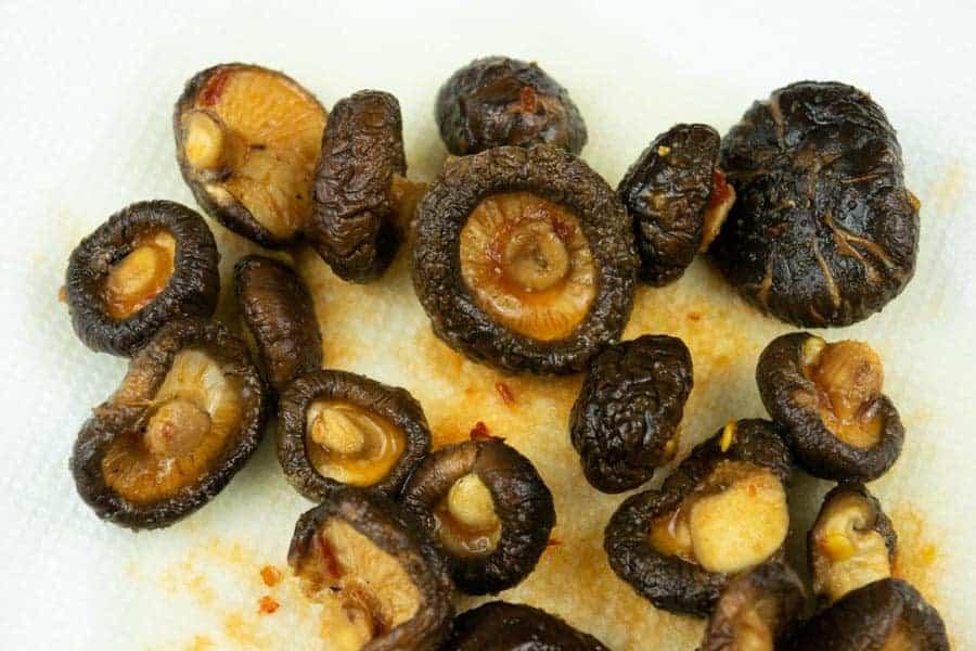 Marinade soaked shiitake mushrooms on paper towel
