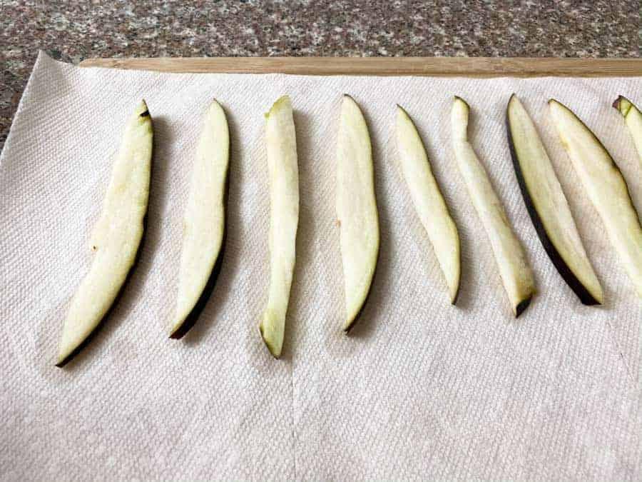wet Eggplant slices on paper towel