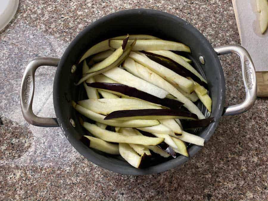 Eggplant slices in colander