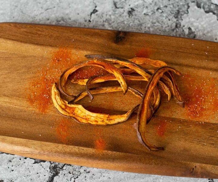 Tomato Eggplant jerky on wood cutting board