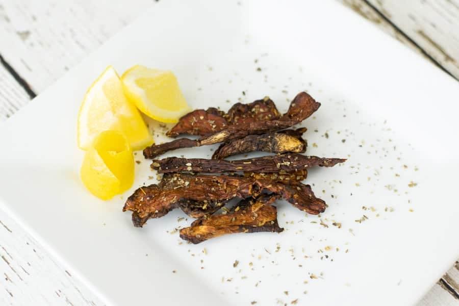 slices of lemon and mushroom jerky on plate