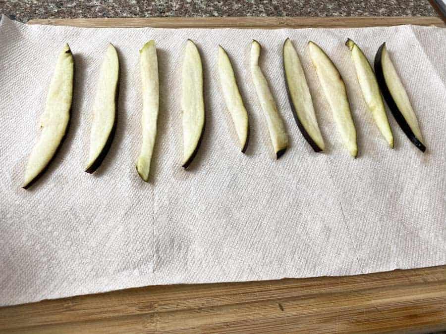 Eggplant slices on paper towel
