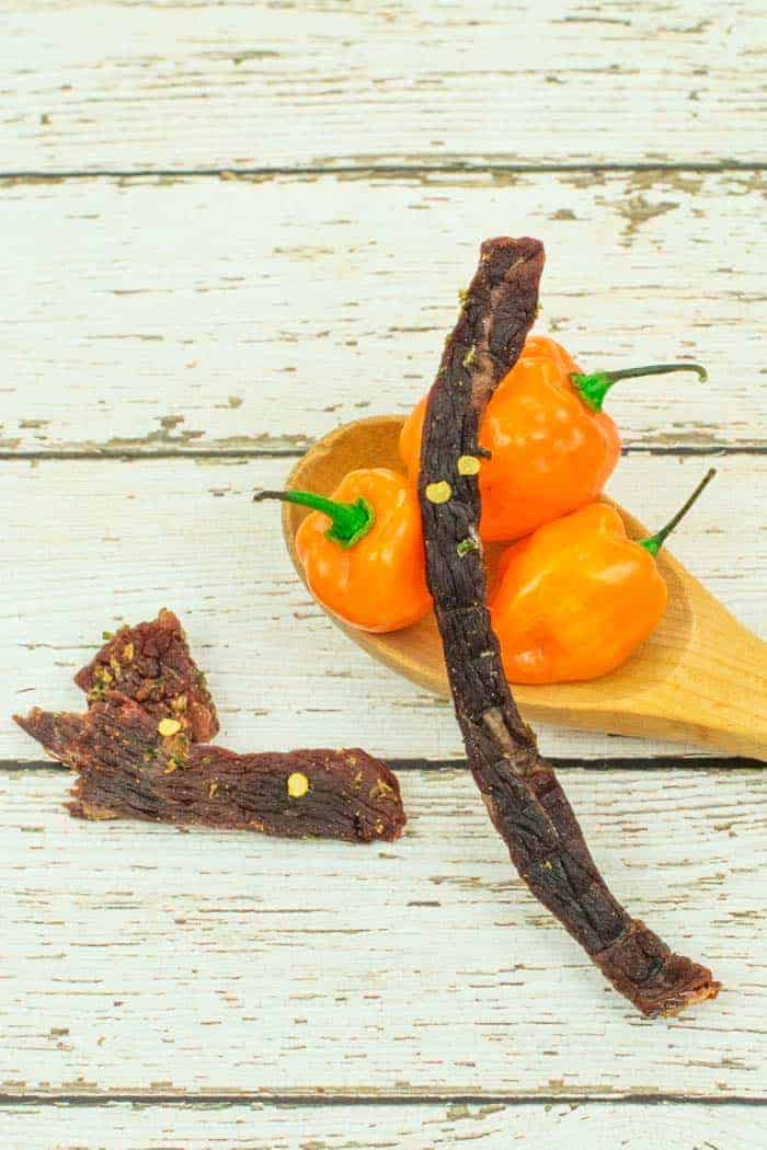 Beef jerky with habanero peppers on wood table