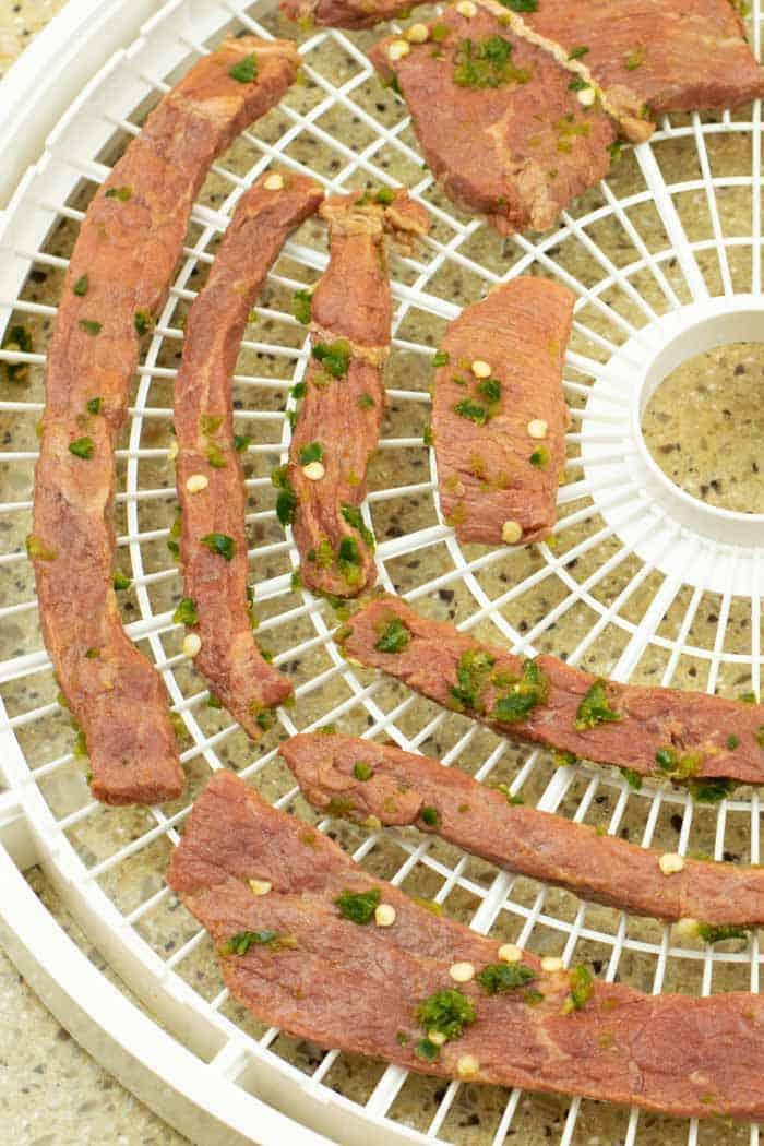 beef jerky on dehydrator trays