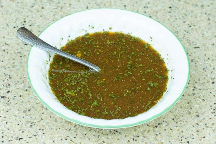 Jerky marinade in bowl with spoon