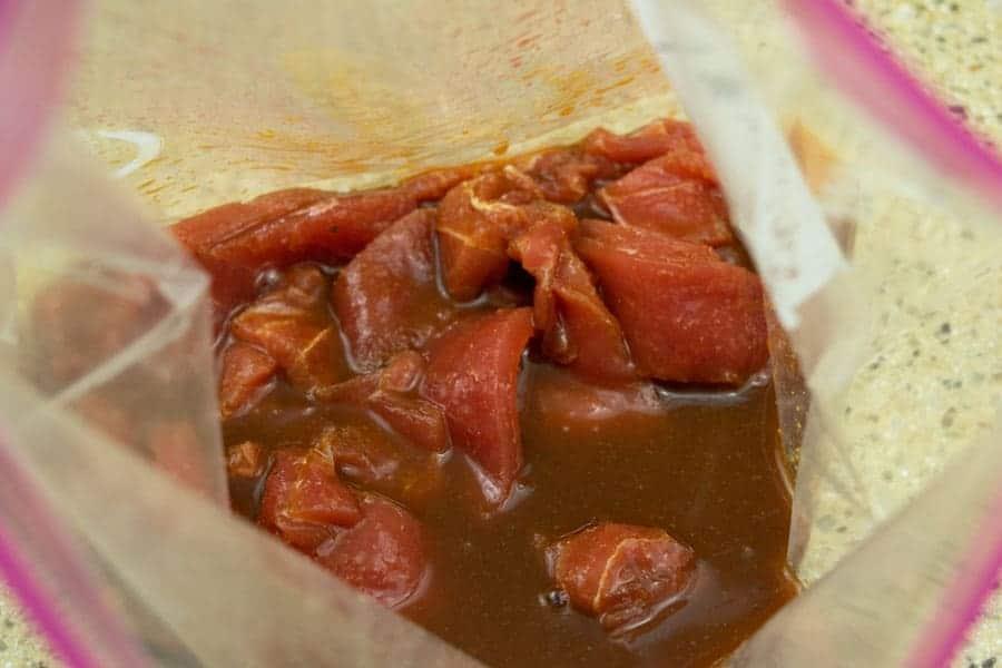 tuna jerky strips marinating in marinade