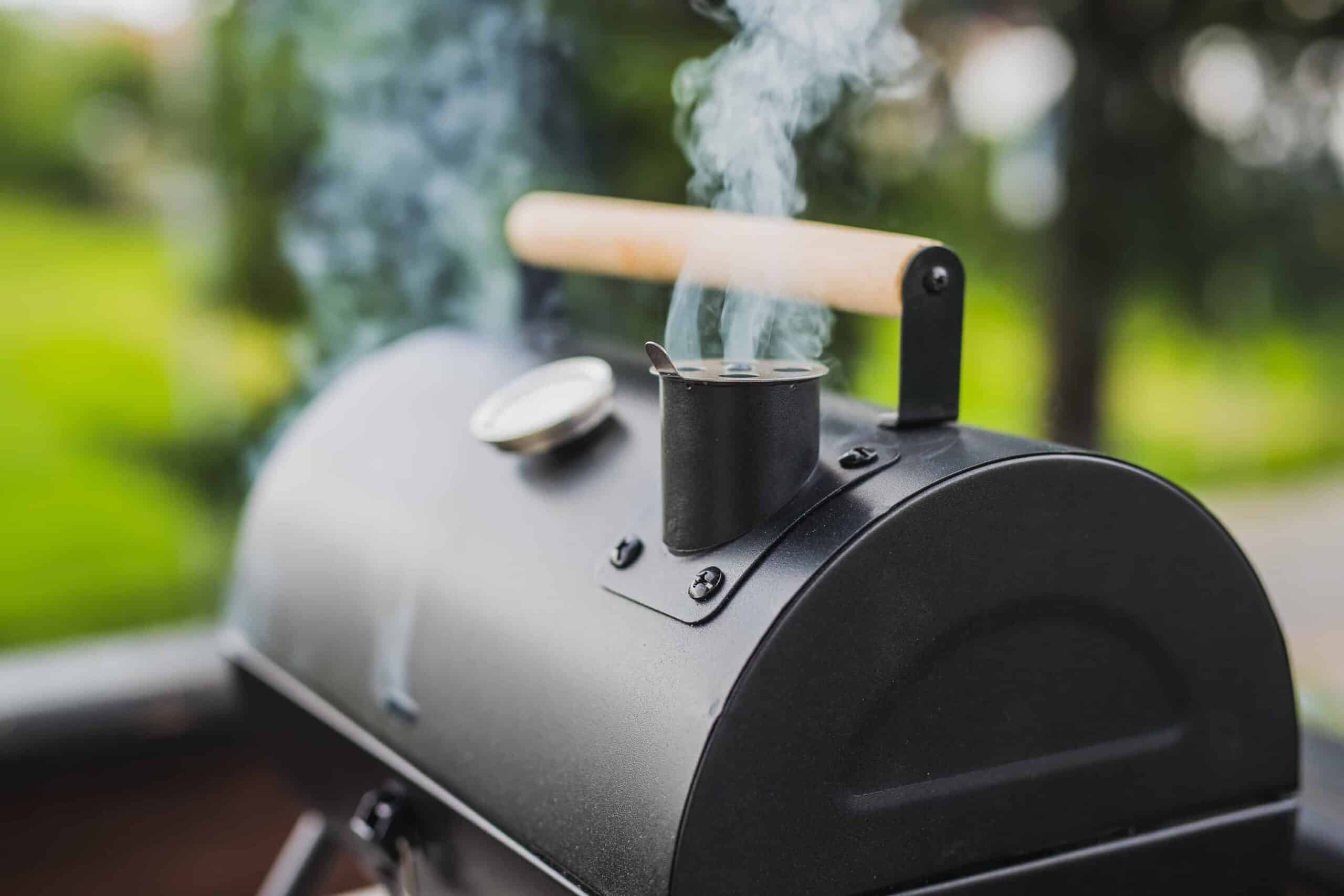 Smoker grill with smoke coming out