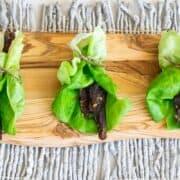 venison jerky in lettuce wraps on cutting board