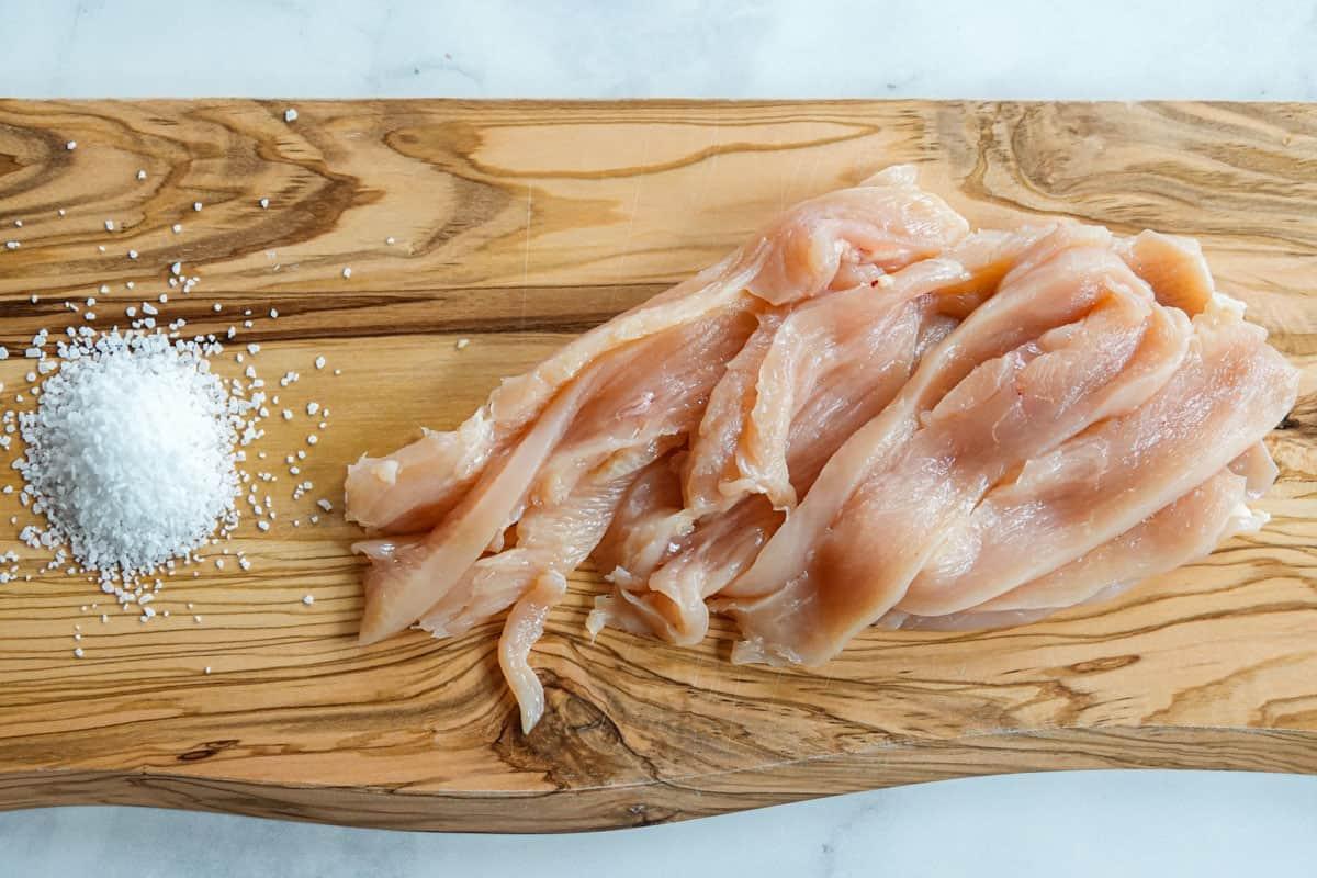 Turkey sliced into jerky strips on cutting board