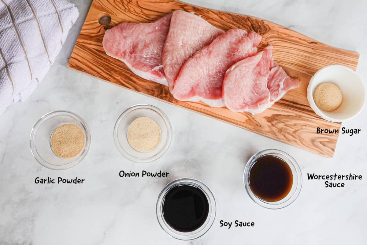 Turkey on cutting board with spices for jerky