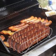 Rib rack on grill with ribs and sausages