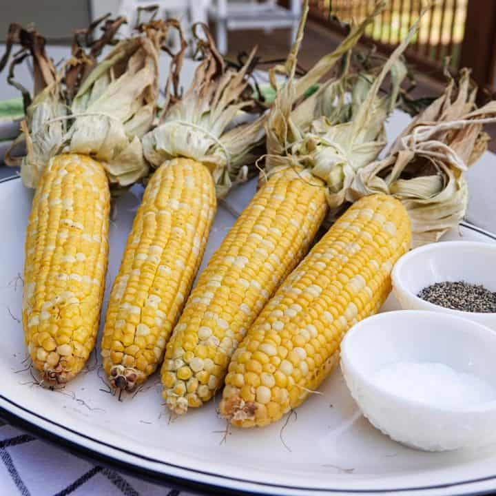 Corn on plate with salt and pepper
