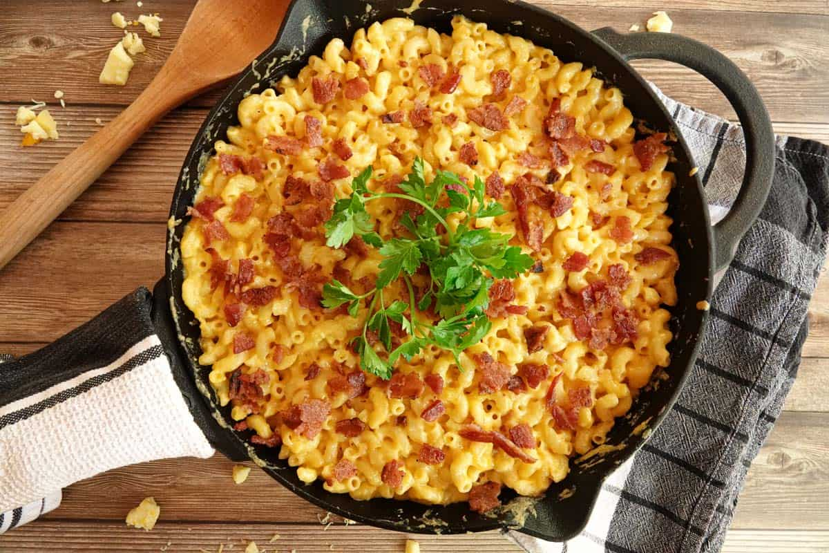 smoked mac and cheese in cast iron with spoon on side