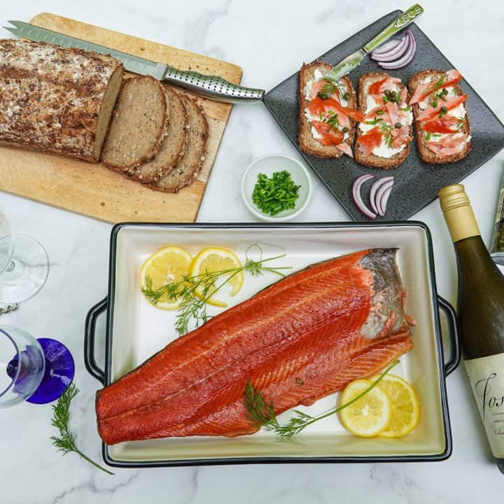 trout in dish with toast and bottle of wine